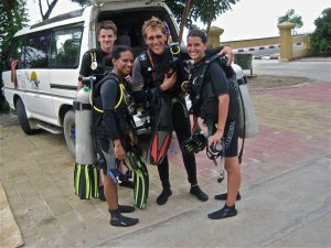 Dive Timor instructor with students and local guide Nafe