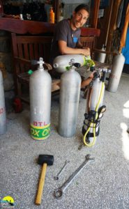 Technician Ivan servicing tanks at Dive Timor