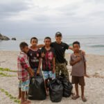 Local kids at dili rock, timor leste